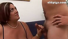 Lesson of sex of a mother to her dork son!