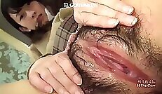 Beautiful Oriental touches down on her wet hairy pussy