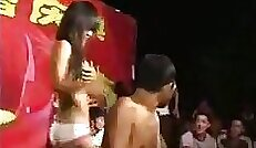 Chinese girl shines in the nude on public road