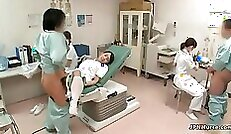 Asian nurse on the ropes, startled and helpless